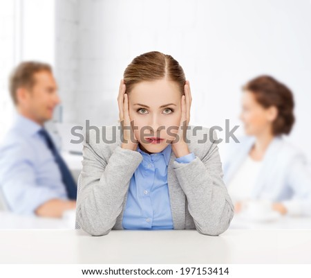 business and office concept - stressed businesswoman covering her ears with hands - stock photo