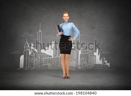business and office concept - young smiling businesswoman with folder and city drawing in the back - stock photo