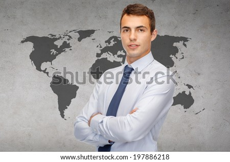 business and office, people concept - friendly young businessman with crossed arms - stock photo