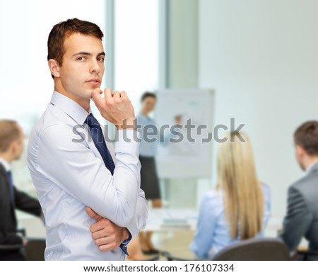 business and office, people concept - pensive young buisnessman at office - stock photo