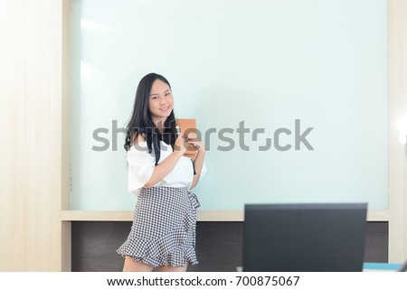 business and people concept - smiling businesswoman presentation in office