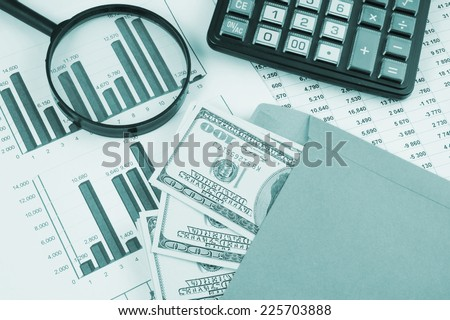 Business and profits concept with calculator, money in envelope and documents