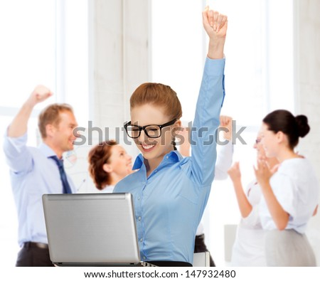 business and success - happy businesswoman with computer in office - stock photo