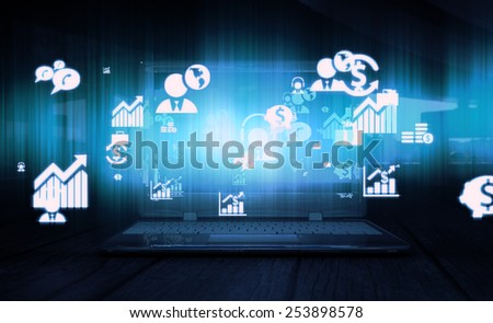 Business and technology related icons and symbols flashing out of laptop screen - stock photo