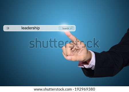 Business and technology, searching system and internet concept - male hand pressing Search leadership button.
