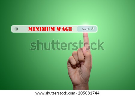 Business and technology, searching system and internet concept - male hand pressing Search MINIMUM WAGE button.  - stock photo