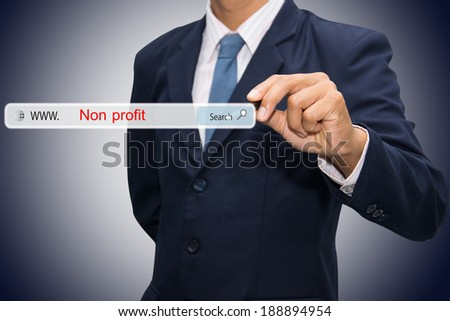 Business and technology, searching system and internet concept - male hand pressing Search Non profit button.  - stock photo