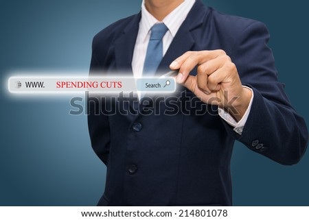 Business and technology, searching system and internet concept - male hand pressing Search SPENDING CUTS button.  - stock photo