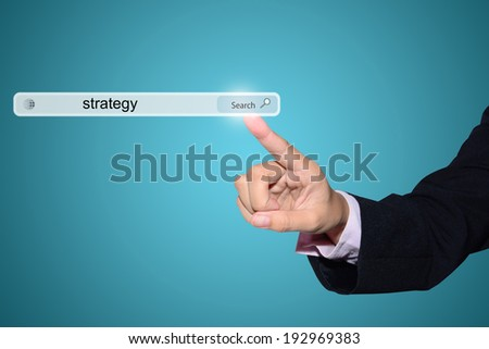 Business and technology, searching system and internet concept - male hand pressing Search strategy button.