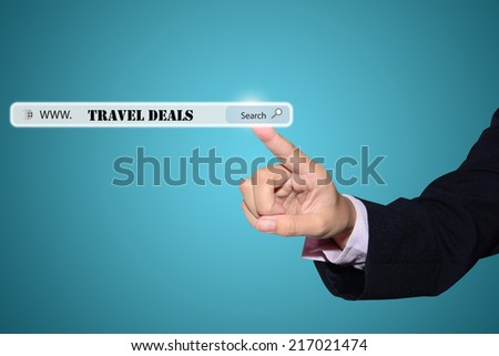 Business and technology, searching system and internet concept - male hand pressing Search TRAVEL DEALS button.