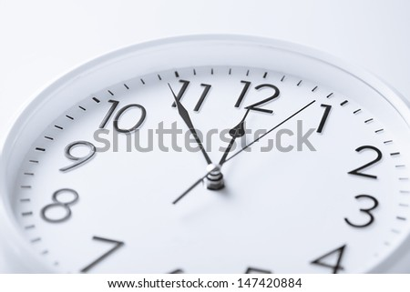 business and time concept - wall clock over white - stock photo