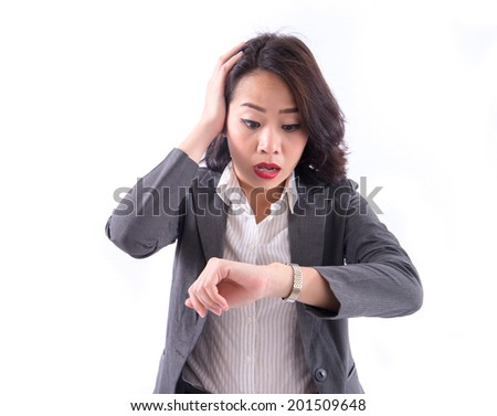business and time management concept.stressed businesswoman looking at clock - stock photo