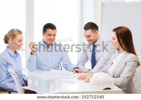 business, architecture and office concept - happy team of architects and designers in office - stock photo