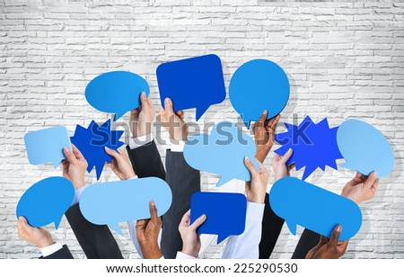 Business arms raised with speech bubble by brick wall. - stock photo