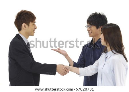 Business asian group -handsome young man shaking hands with a woman