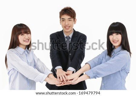 Business asian group -handsome young man shaking hands with two woman - stock photo