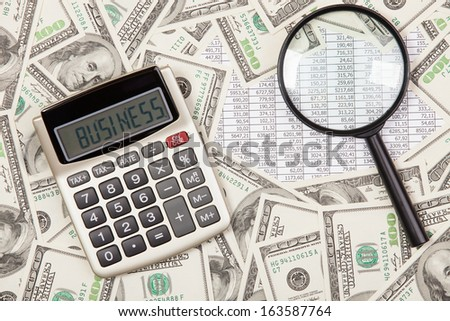 Business background. Calculator with word BUSINESS - stock photo
