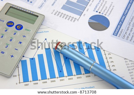 Business Background: Financial report, pen and Calculator