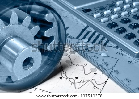 Business background in blues with calculator, gears and graph. - stock photo