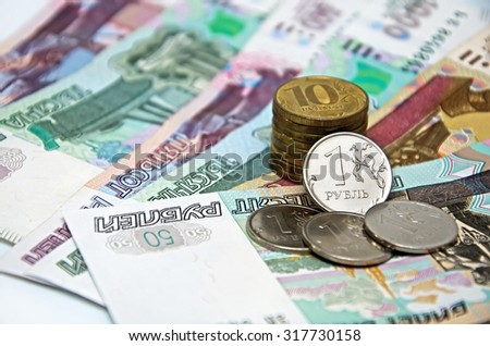 Business background - Metal coins on paper bills and (Russian rubles)