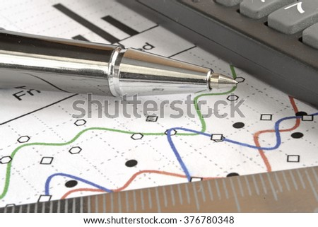 Business background with graph, ruler, pen and calculator. - stock photo