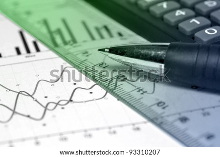 Business background with graph, ruler, pen and calculator, green and blue. - stock photo