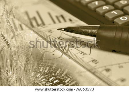 Business background with graph, ruler, pen and wheat, in sepia.