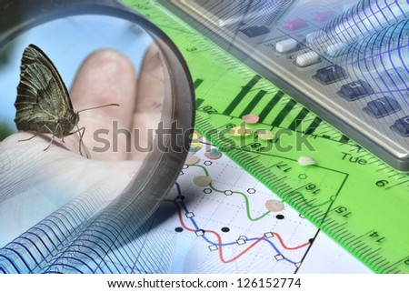 Business background with hand, buildings and graph. - stock photo