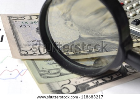 Business background with money, magnifier and pen.