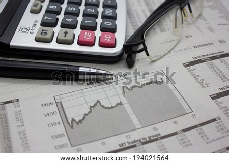 Business background with money, pen and calculator.
