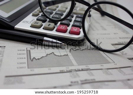 Business background with money, pen and calculator. - stock photo