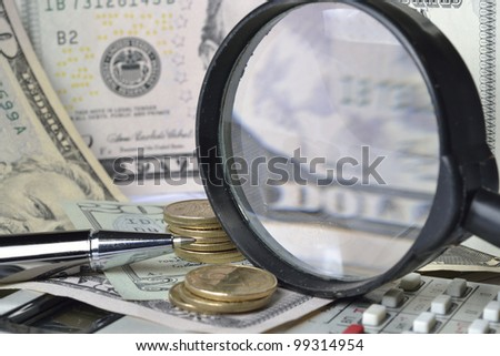 Business background with table, money, pen and calculator. - stock photo