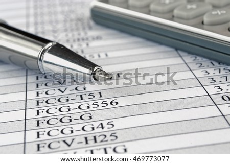 Business background with table, pen and calculator.