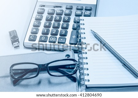 Business background with tablet and office items