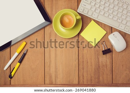 Business background with tablet, keyboard and coffee cup. View from above - stock photo
