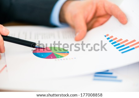 Business - banker, Manager or expert evaluates the figures on and compares the development of the business in real time to quickly and efficient advise and act as consultant - stock photo