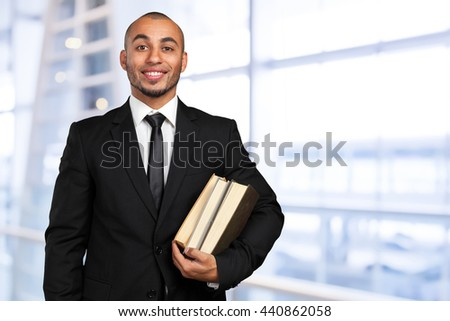 business black man holding a book - stock photo