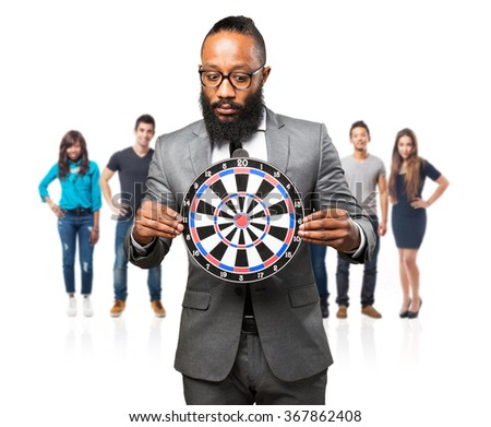 business black man holding a dartboard - stock photo