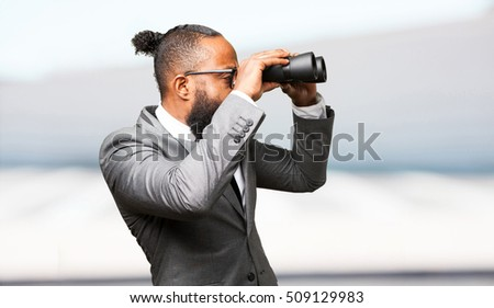 business black man holding binoculars