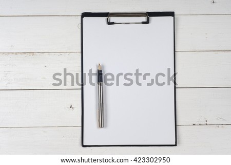 Business blank,  and pen at office desk table top view. Corporate stationery branding mock-up.  Copy space for text. - stock photo