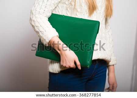 Business blonde woman with green folder, isolated - stock photo