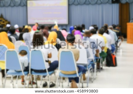 Business  blur blurred abstract education training conference in room seminar meeting,  analyze Statistics Financial Concept with  projector Movie screen. - stock photo