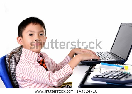 Business boy working with laptop - stock photo