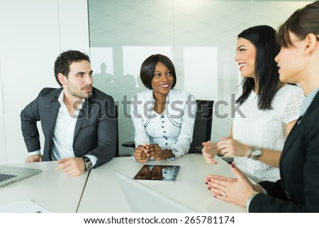 Business brainstorming and exchange of ideas by colleagues in a beautiful office - stock photo