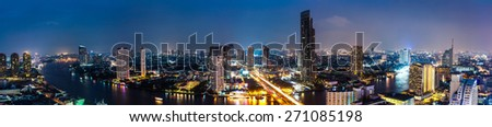 Business Building Bangkok city area at night life with transportation car and ship as panorama, high angle bird eyes view - stock photo