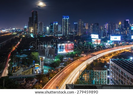Business Building Bangkok city area at night life with transportation way and moon, logistic concept high angle bird eyes view
