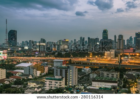 Business Building Bangkok city area at night life with transportation way, logistic concept high angle bird eyes view