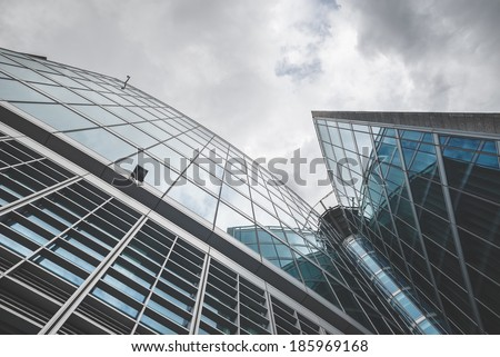 business building skyscraper mirrors reflection - stock photo