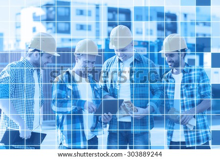 business, building, teamwork, technology and people concept - group of smiling builders in hardhats with tablet pc computer and clipboard outdoors over blue squared grid background