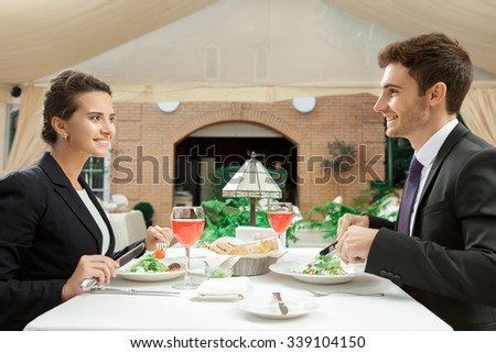 Business built on trust. Vertical half length portrait of two co-workers meeting for lunch in the restaurant - stock photo